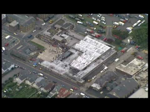 Exterior aerial shots aftermath of bomb blast at Royal Marines School of Music Aerial shots damaged area at barracks rescue vehicles at site