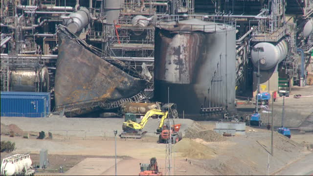 stockvideo's en b-roll-footage met exterior aerial shots aftermath of explosion fire at the chevron oil refinery at pembroke dock chevron oil refinery fire aftermath aerials on june 03... - pembrokeshire