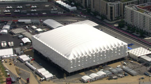 exterior aerial shots basketball arena venue for the olympic basketball event showing olympic rings logo at the entrance sky news 2012 olympics... - ロンドン ストラトフォード点の映像素材/bロール