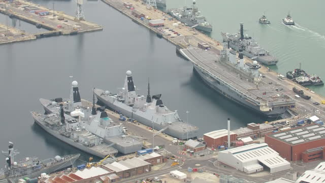 exterior aerial shots british royal navy type 45 destroyer warships docked at hmnb portsmouth with decommissioned royal navy aircraft carrier hms... - hms illustrious r06 stock videos and b-roll footage