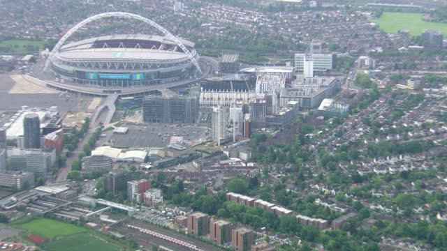 exterior aerial shots construction site near wembley stadium where world war ii bomb has been found, police officers at scene on may 22, 2015 in... - war stock-videos und b-roll-filmmaterial