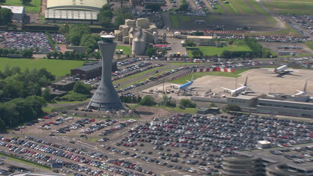 exterior aerial shots edinburgh airport with shots of the air traffic control tower and planes parked at terminal stands. on june 11th, 2014 in... - edinburgh scotland stock videos & royalty-free footage