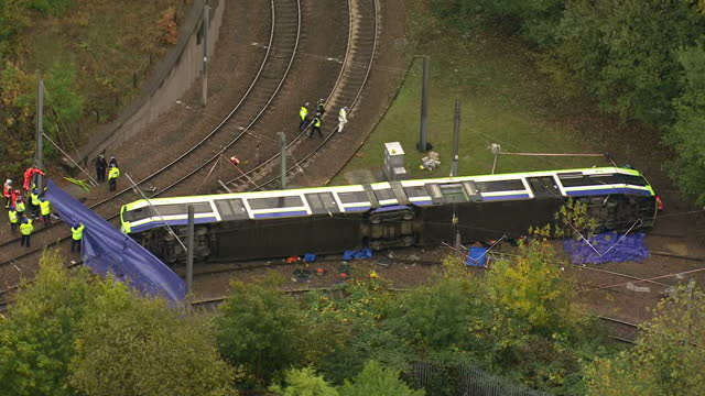 exterior aerial shots emergency services at scene of tram derailment with emergency workers on tracks trying to free trapped passengers. on november... - croydon england stock videos & royalty-free footage