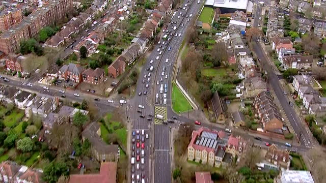exterior aerial shots following traffic along an elevated section of the a4 into london from the m25 on december 23, 2016 in london, england. - m25 video stock e b–roll