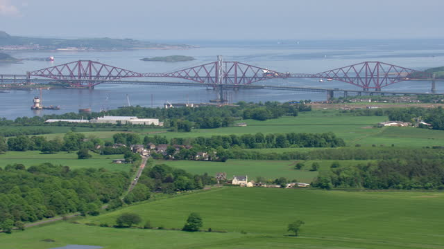 exterior aerial shots forth railway bridge over the firth of forth and coastline countryside on june 11th 2014 in edinburgh scotland - fluss firth of forth stock-videos und b-roll-filmmaterial