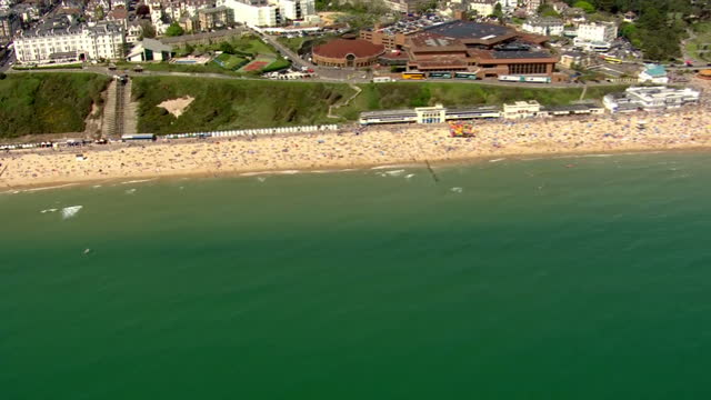 exterior aerial shots of a busy bournemouth beach with a large number of people sunbathing on the hottest day of the year so far on may 08 2016 in... - bournemouth england stock videos & royalty-free footage