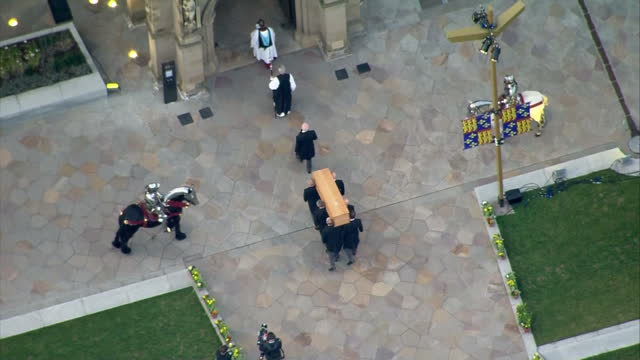 exterior aerial shots of a coffin carrying the remains of king richard 3rd being carried into leicester cathedral on march 23 2015 in leicester... - レスターシャー点の映像素材/bロール