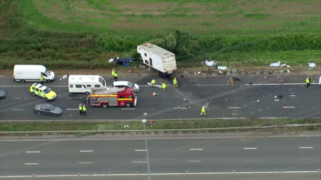 exterior aerial shots of a crashed lorry and cars on the m5 motorway in the aftermath of a crash which killed four people on 16 september 2017 in... - wreck stock videos & royalty-free footage