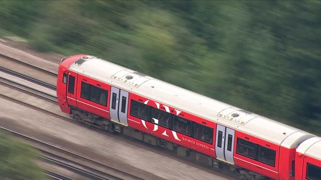exterior aerial shots of a gatwick express train and gatwick airport terminal and planes on 5 september 2018 in gatwick, united kingdom - gatwick airport stock videos & royalty-free footage