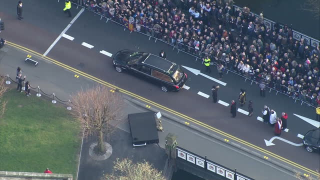 exterior aerial shots of a hearse carrying the remains of richard 111 through the crowd packed streets of the city of leicester on march 23 2015 in... - funeral procession stock videos & royalty-free footage