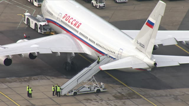 Exterior aerial shots of a Russian passenger plane parked at a terminal at Stansted airport to transport expelled Russian embassy staff home in the...