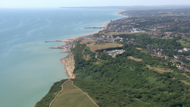 exterior aerial shots of a traffic jam approaching camber sands beach and cars parked on verges at the roadside on the hottest day in 17 years and a... - east sussex stock videos & royalty-free footage