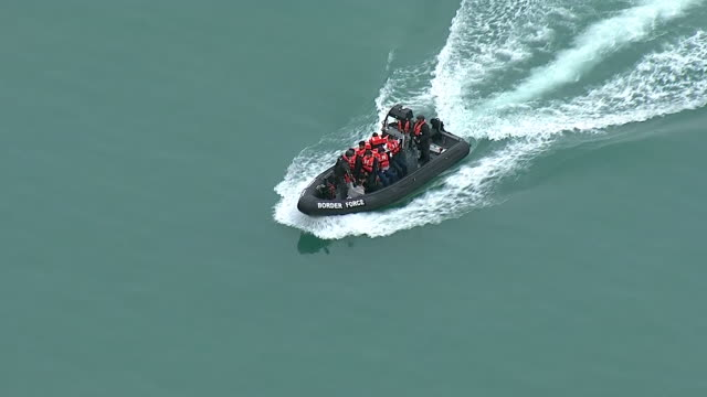 exterior aerial shots of a uk border force speedboat with detained migrants on board sailing into dover harbour on 27 december 2018 in dover united... - exile stock videos & royalty-free footage