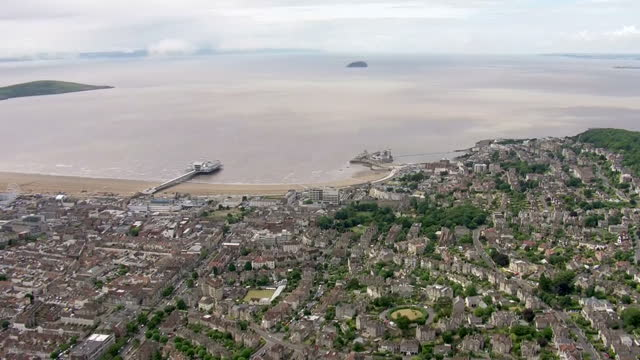 exterior aerial shots of abandoned birnbeck pier and surrounding beachfront and the town of weston super mare on july 29 2016 in westonsupermare... - weston super mare stock videos and b-roll footage