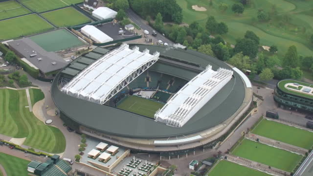 exterior aerial shots of all england club wimbledon court 1's new retracting roof ahead of the wimbledon tennis championships on 17 may 2019 in... - roof stock videos & royalty-free footage