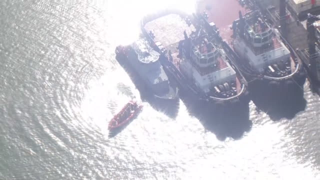 exterior aerial shots of an hm border force patrol vessel moored at dover with rescued migrants on its deck and recovered migrant dinghies moored on... - dover kent stock-videos und b-roll-filmmaterial
