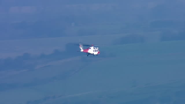 Exterior aerial shots of an HM Coast Guard helicopter in flight on patrol over the English Channel on 4 September 2019 in Kent United Kingdom