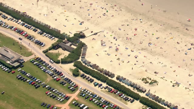 exterior aerial shots of bournemouth beach on a sunny day with people sunbathing and swimming in the sea on 20 june 2017 in bournemouth united kingdom - bournemouth stock-videos und b-roll-filmmaterial
