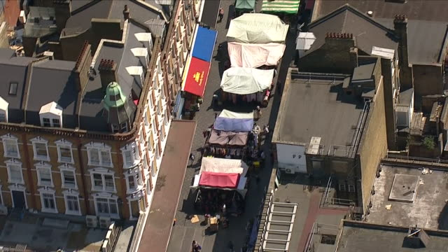 exterior aerial shots of brixton market including brixton station road market and market stalls and shops on 2 july 2018 in london united kingdom - ブリックストン点の映像素材/bロール