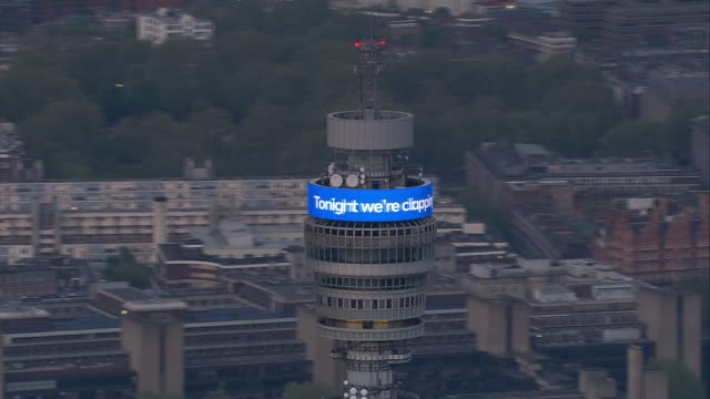 vídeos de stock e filmes b-roll de exterior aerial shots of bt tower london message for the nhs on 23 april 2020 in london united kingdom - bt tower londres