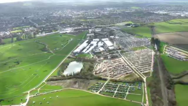 exterior aerial shots of cheltenham race course with punters gathered prior to the gold cup on 13 march 2020 in cheltenham, united kingdom - cheltenham stock videos & royalty-free footage