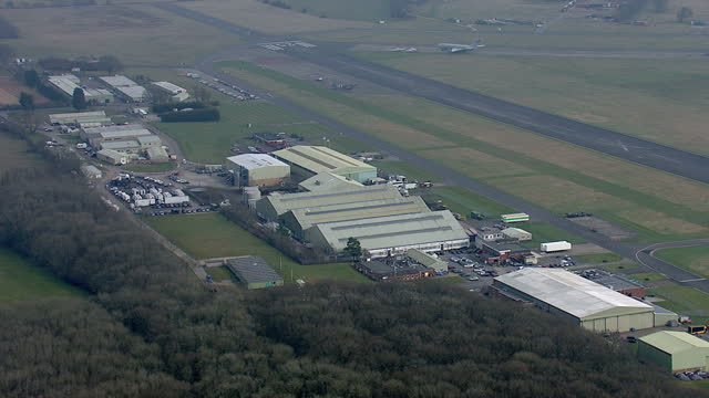 exterior aerial shots of dunsfold aerodrome including the hangars where bbc's top gear starring jeremy clarkson is filmed and the runway which forms... - richard hammond stock videos & royalty-free footage