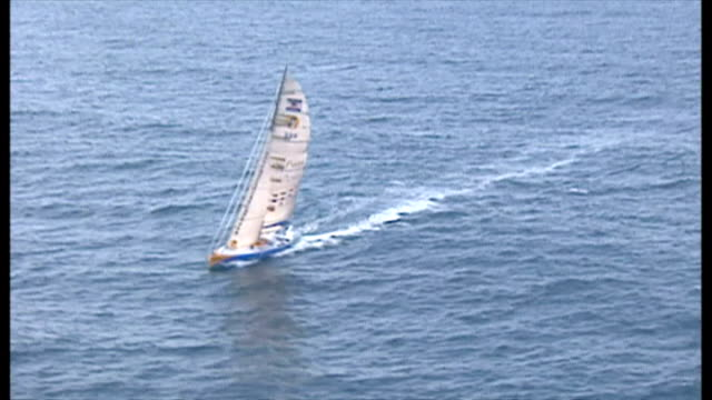 exterior aerial shots of ellen macarthur's kingfisher yacht sailing at sea, competing in the 2001 vendee globe round the world race on february 12,... - circumnavigation stock videos & royalty-free footage