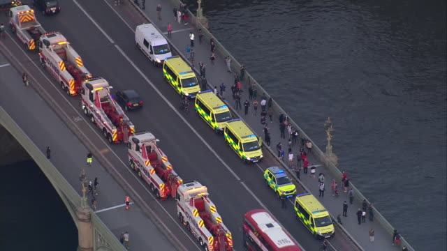 exterior aerial shots of emergency services salute the nhs on westminster bridge on 23 april 2020 in london united kingdom - saluting stock videos & royalty-free footage