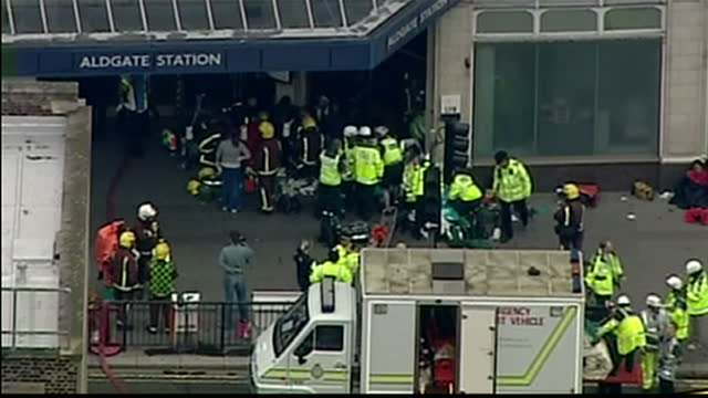 exterior & aerial shots of emergency services & survivors at kings cross & aldgate underground stations following the 7/7 bombings in london.... - terrorism stock videos & royalty-free footage