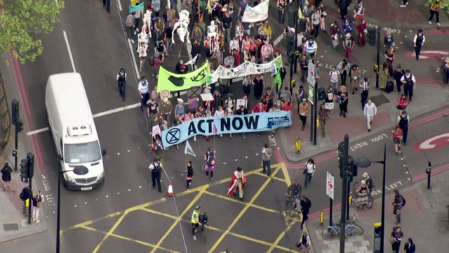 exterior aerial shots of extinction rebellion march from marble arch to parliament square on 23rd april 2019 in london, england. - environment stock videos & royalty-free footage