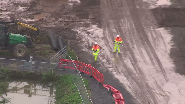 exterior aerial shots of flooded fields with jcb's and workmen building flood defences in the somerset levels on november 13 2014 in muchelney england - somerset levels stock videos and b-roll footage