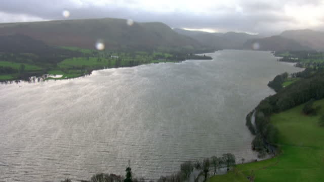 exterior aerial shots of flooded roads and countryside at pooley bridge including a flooded house on december 08 2015 in carlisle england - northwest england stock videos and b-roll footage