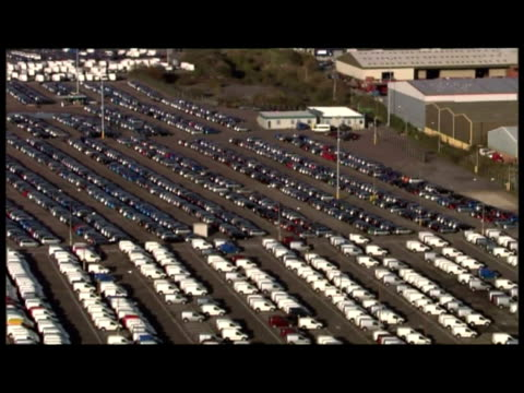 exterior aerial shots of ford's dagenham plant with rows or new ford cars parked exterior aerial shots of lorries and cars driving off ferry at... - {{asset.href}} stock videos & royalty-free footage