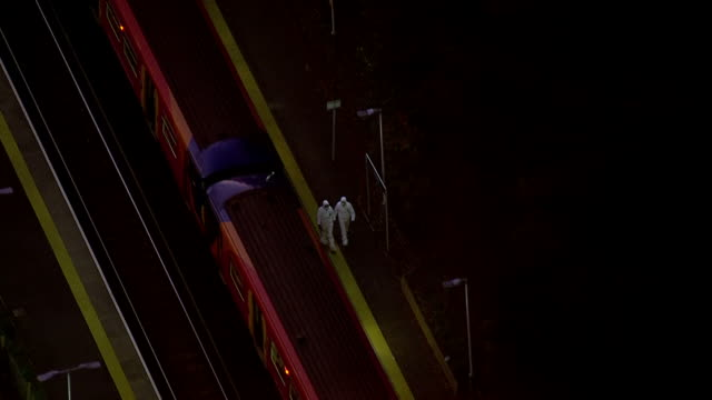 exterior aerial shots of forensic officers combing a station platform next to a stationary train on 4 january 2019 in guildford united kingdom - combing stock videos & royalty-free footage