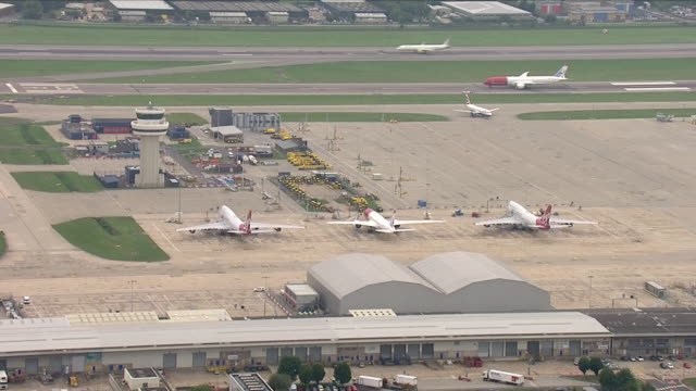 exterior aerial shots of gatwick airport with planes at various terminal stands on 5 september 2018 in gatwick, united kingdom - gatwick airport stock videos & royalty-free footage