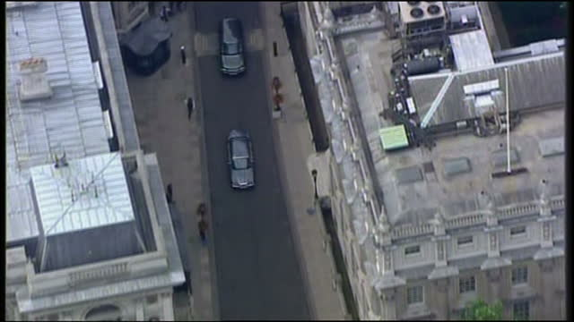 Exterior aerial shots of Gordon and Sarah Brown departing Number 11 Downing Street in car driving through London streets before arriving at...