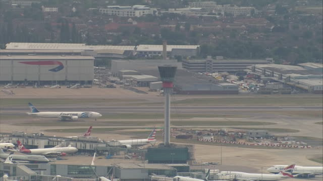 exterior aerial shots of heathrow airport air traffic control tower planes tarmac on the hottest july day on 25th july 2019 in london england - day stock videos & royalty-free footage