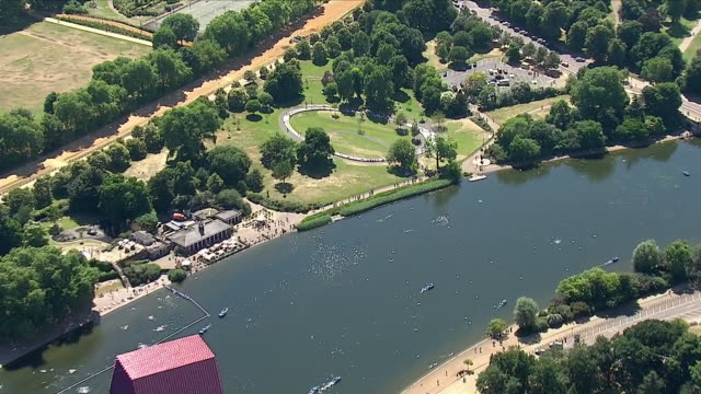 exterior aerial shots of hyde park london in sunny weather including deckchairs people in boats on the serpentine people bathing in the diana... - the serpentine london stock videos & royalty-free footage