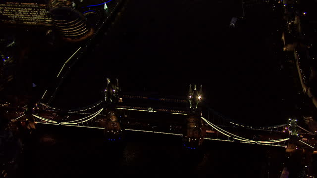 Exterior aerial shots of iconic London buildings at night time including the Shard and Tower of London on December 08 2014 in London England