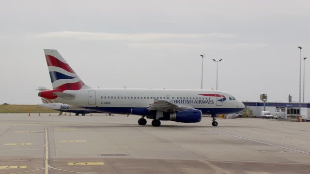 Exterior aerial shots of Jersey Airport including the control tower and a British Airways plane taxiing to the terminal on July 04 2015 in Saint...