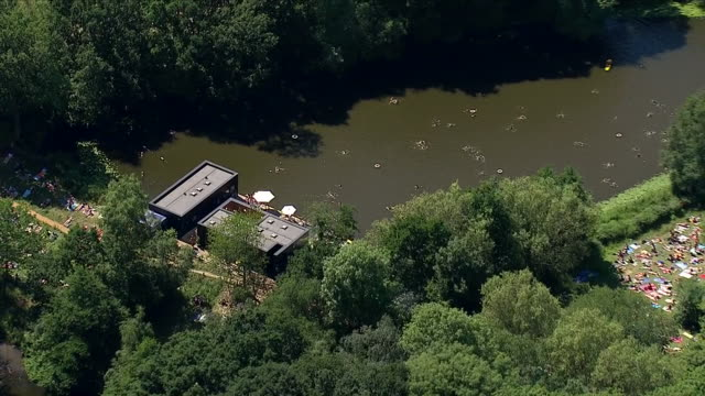 exterior aerial shots of kenwood ladies bathing pond hampstead heath north london including women swimming and sunbathing on 25 june 2018 in london... - swimming stock videos & royalty-free footage
