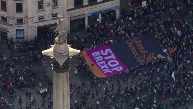 exterior aerial shots of large crowds of peoples vote marchers with some holding a huge stop brexit banner on 19 october 2019 in central london - central london video stock e b–roll