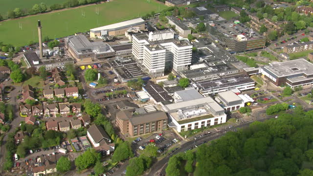 exterior aerial shots of lister hospital with accident and emergency entrance and various departments on 12 may 2017 in stevenage, united kingdom - 国民保険サービス点の映像素材/bロール