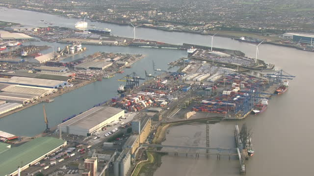 exterior aerial shots of london docklands container port with large numbers of shipping containers and container ships at dockside ready for export... - film container stock videos & royalty-free footage