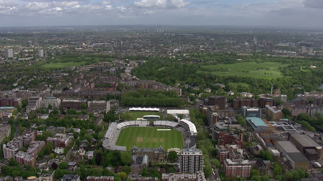 Exterior aerial shots of Lords cricket ground in St Johns Wood including the pavillion nursery ground and media centre on a fairly sunny spring day...
