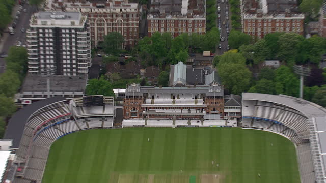 exterior aerial shots of lords cricket ground in st johns wood including the pavillion, nursery ground and media centre on a fairly sunny spring day... - パビリオン点の映像素材/bロール