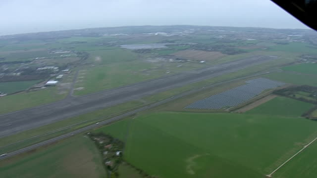 Exterior aerial shots of Manston Airport with runway and nowclosed terminal buildings the site is proposed to be used as a temporary lorry park in...