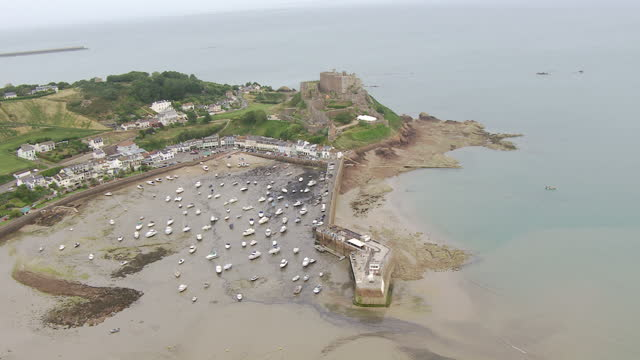 exterior aerial shots of mont orgueil castle and jersey's coastline on july 04, 2015 in saint helier, england. - channel islands england stock videos & royalty-free footage