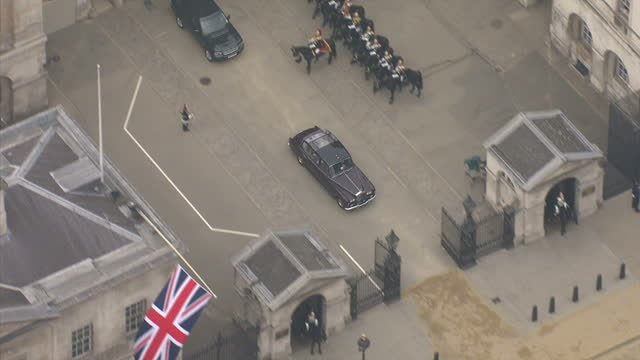 Exterior aerial shots of of the Rolls Royce carrying Kate Middleton to Westminster Abbey travelling through Horseguards and Westminster Sky News...