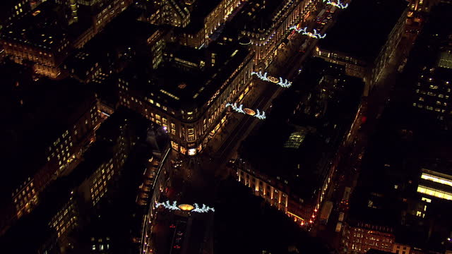 vídeos de stock, filmes e b-roll de exterior aerial shots of picadilly circus and oxford street at night time with christmas lights on december 08 2014 in london england - picadilly
